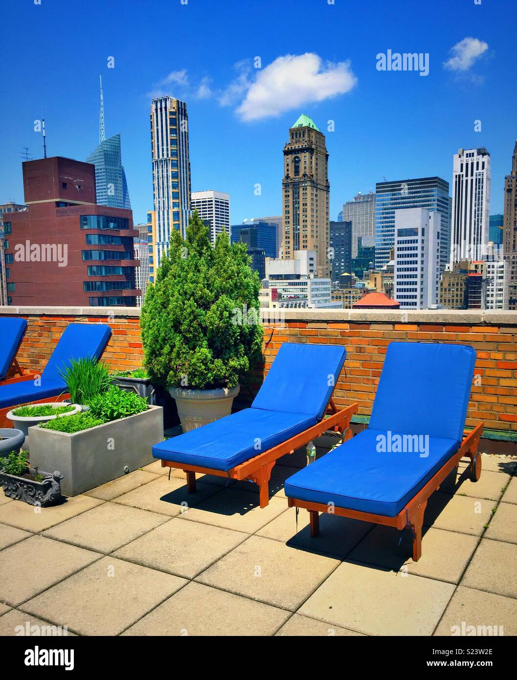 A Rooftop Deck In A Luxury Co Op Apartment Building Overlooks