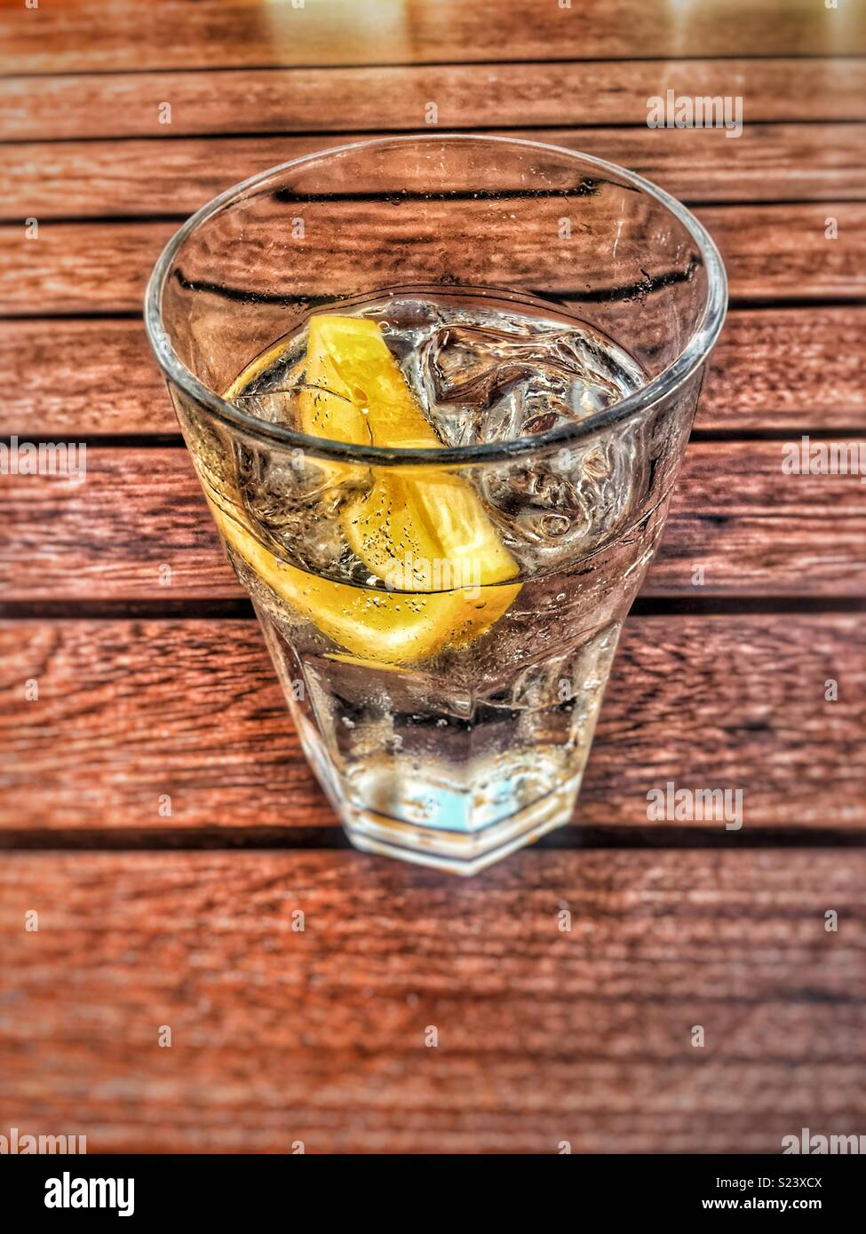 Glass of lemonade on a hot day - Stock Image