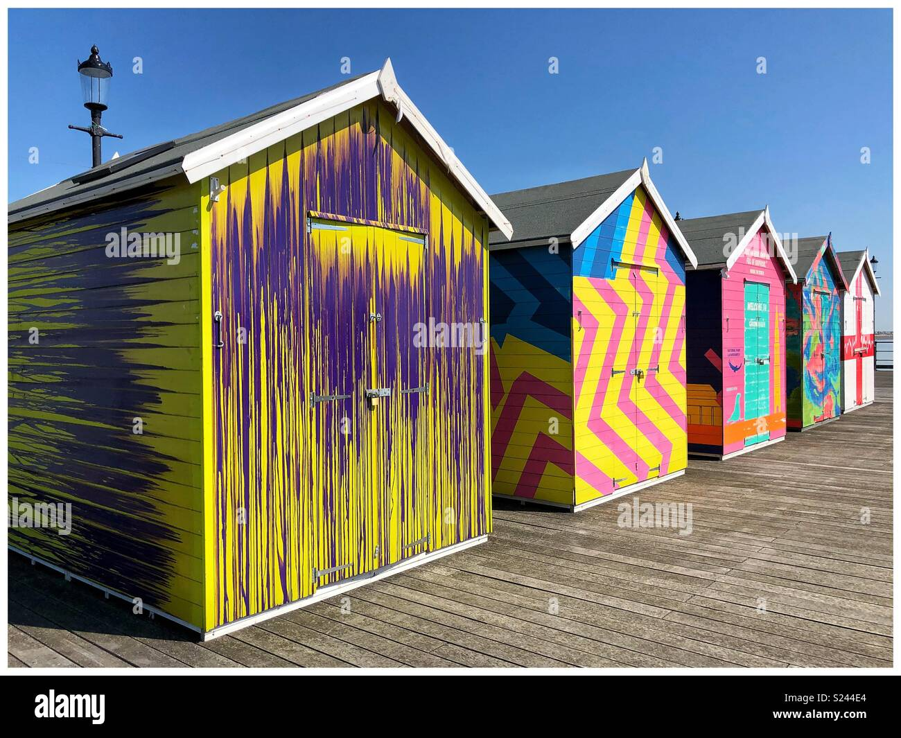 Colourful beach huts at Southend Pier, London - Stock Image