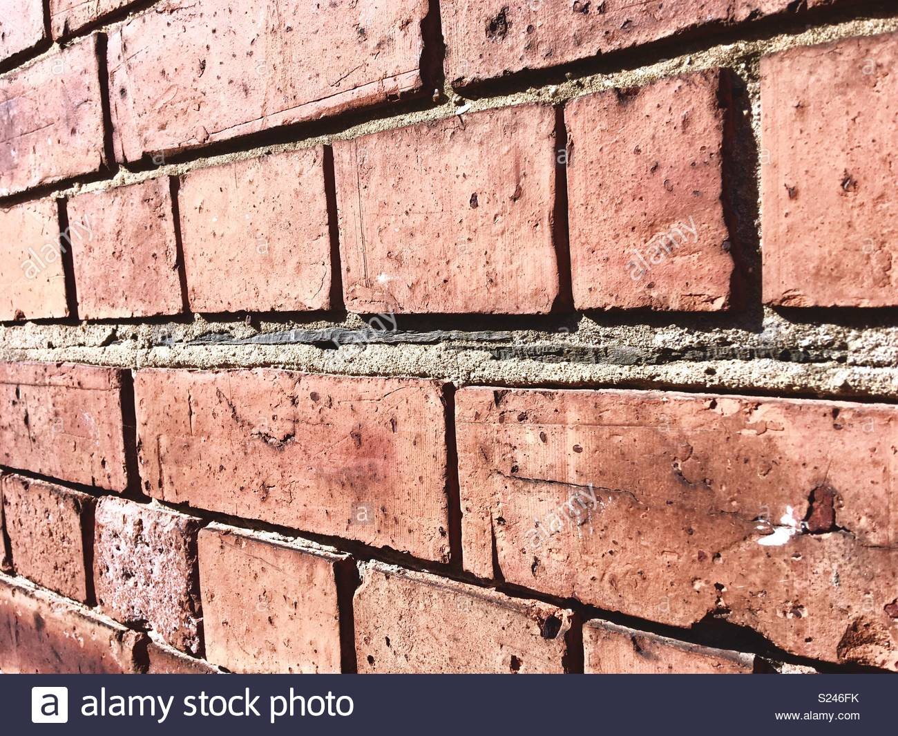 Old fashioned damp proof in a brick wall made from slate - Stock Image