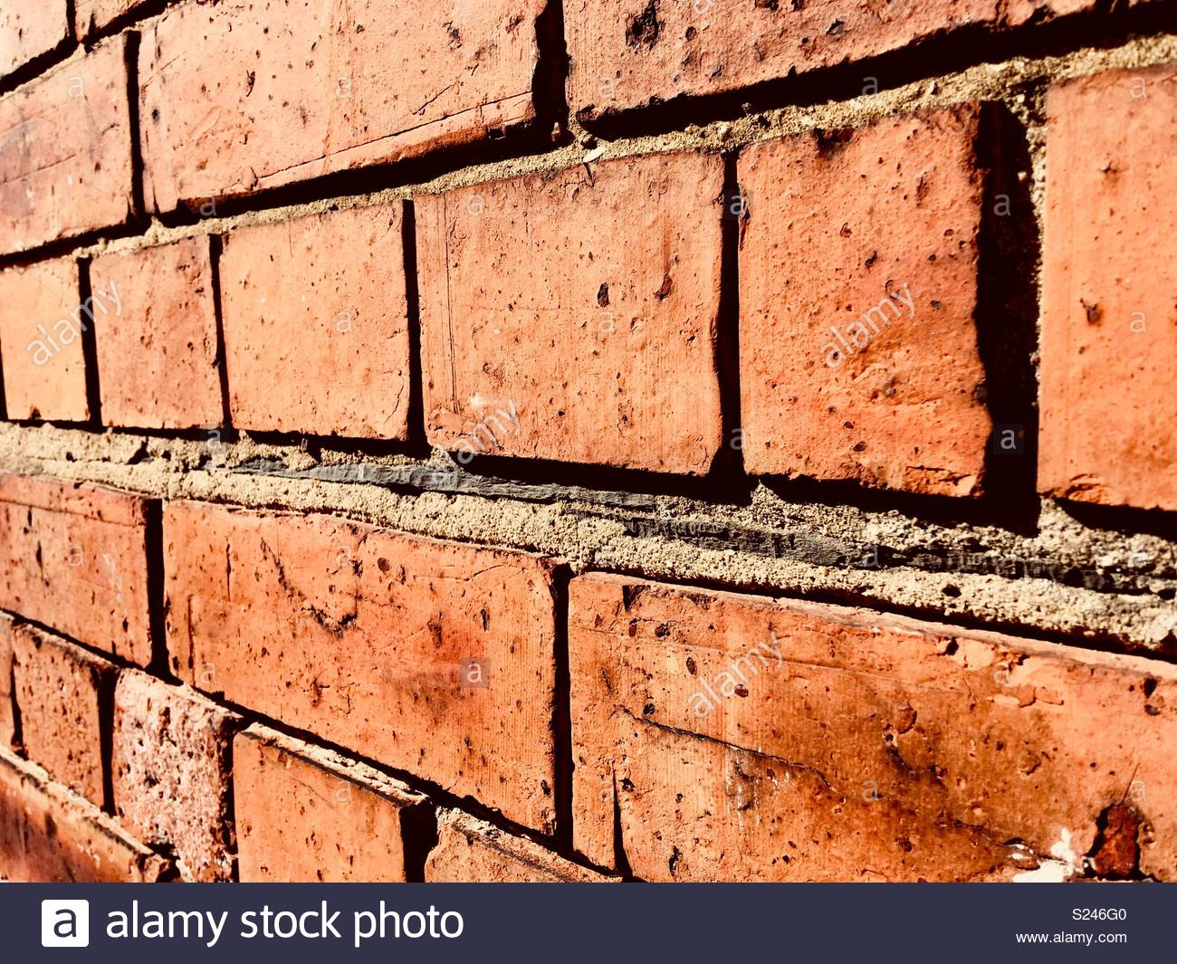 Damp proofing in a brick wall made from slate tiles - Stock Image