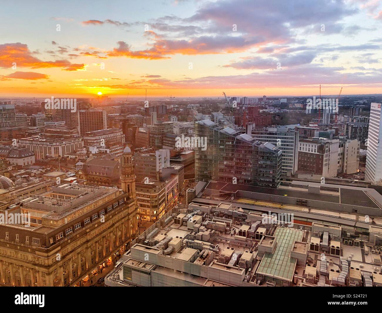 Sunset over Manchester City centre - Stock Image