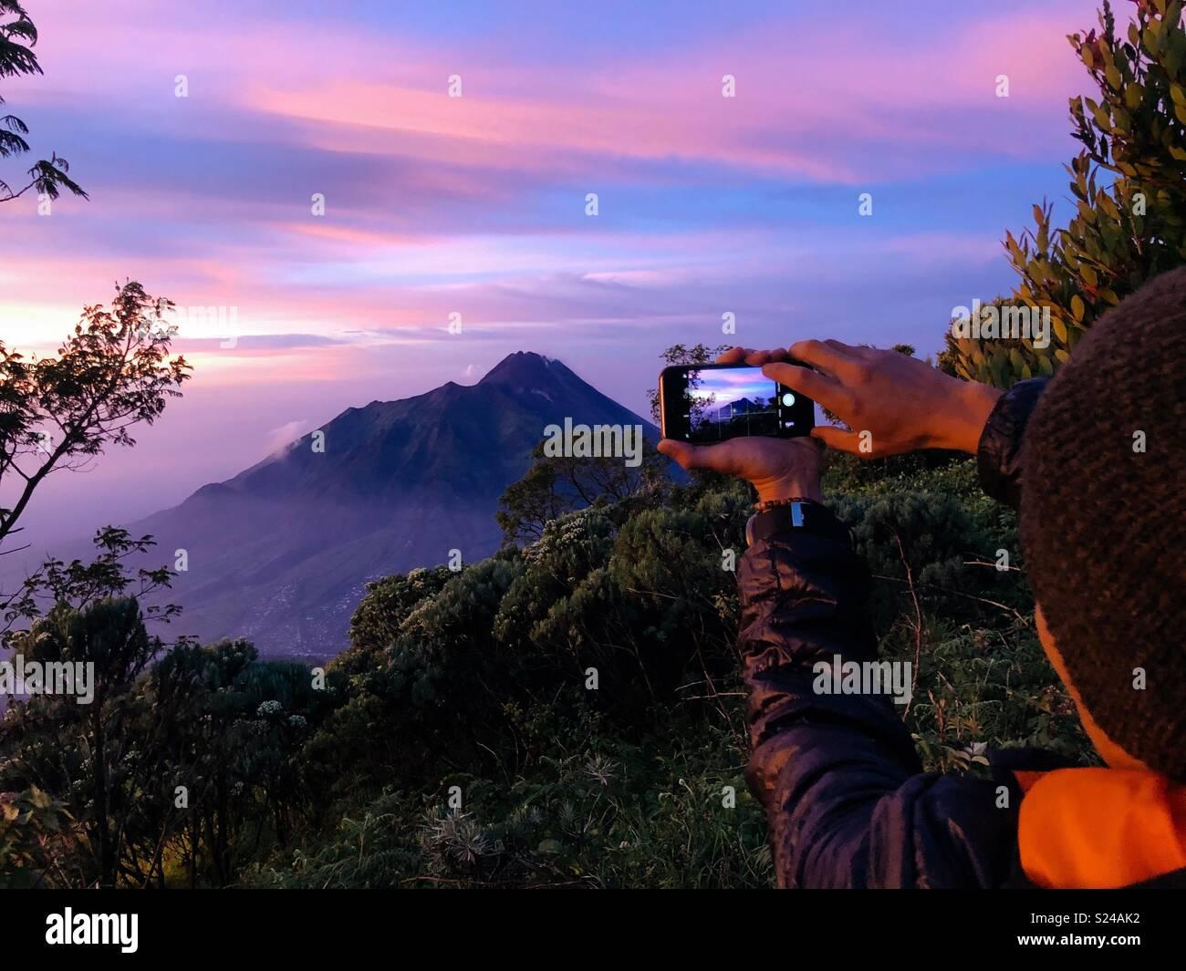Framing Mount Merapi from Mount Merbabu - Stock Image
