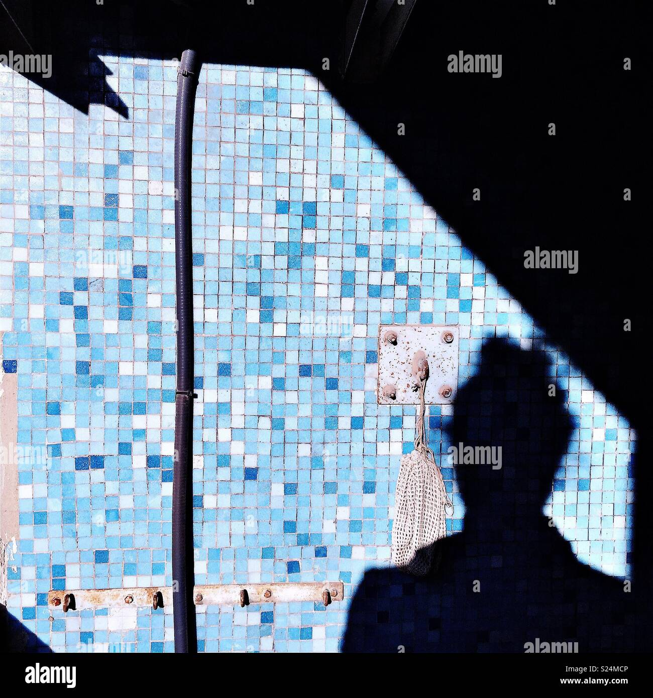 Silhouette of a man in a colored - Stock Image