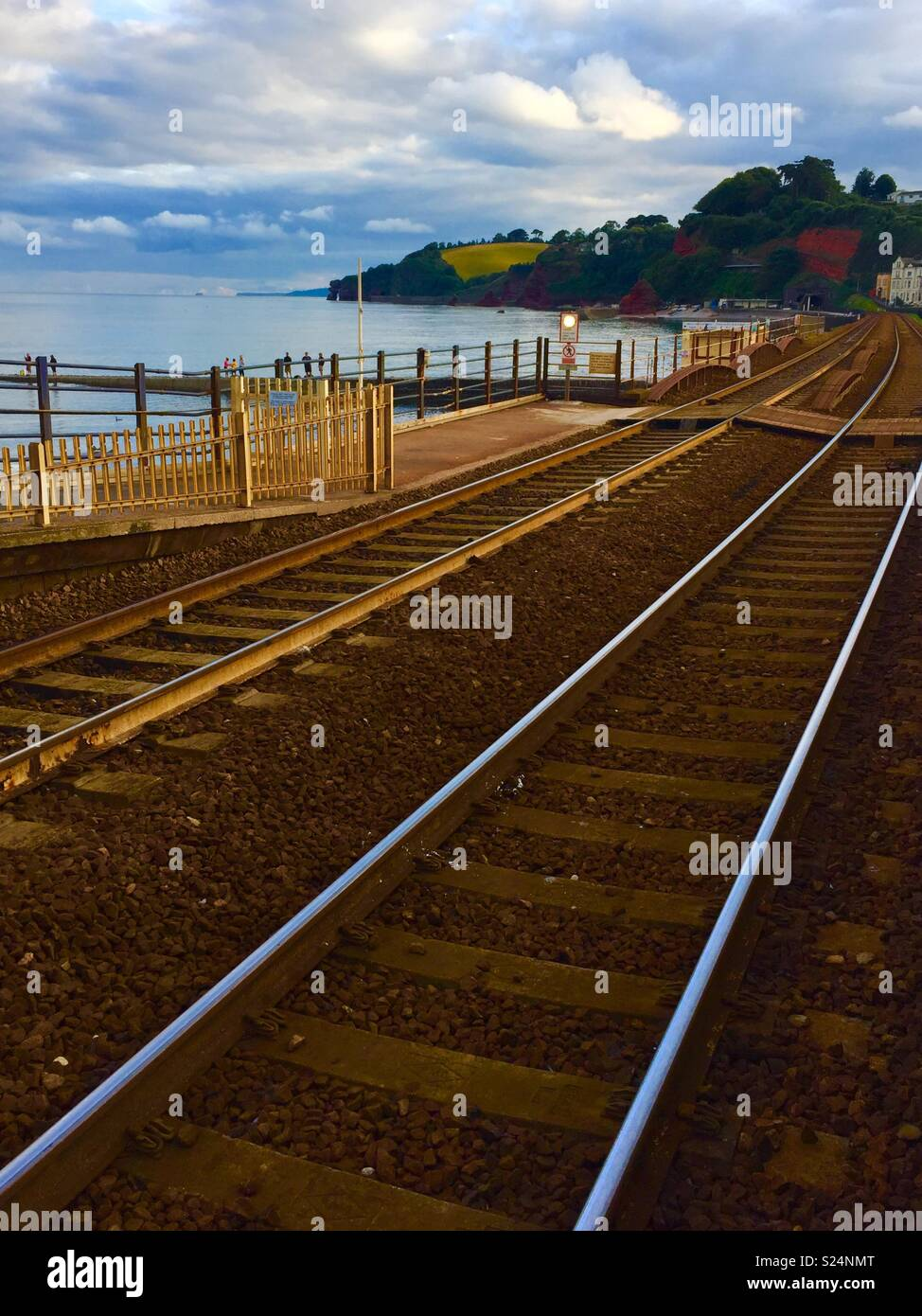 Railway line at Dawlish station looking towards Teignmouth. - Stock Image
