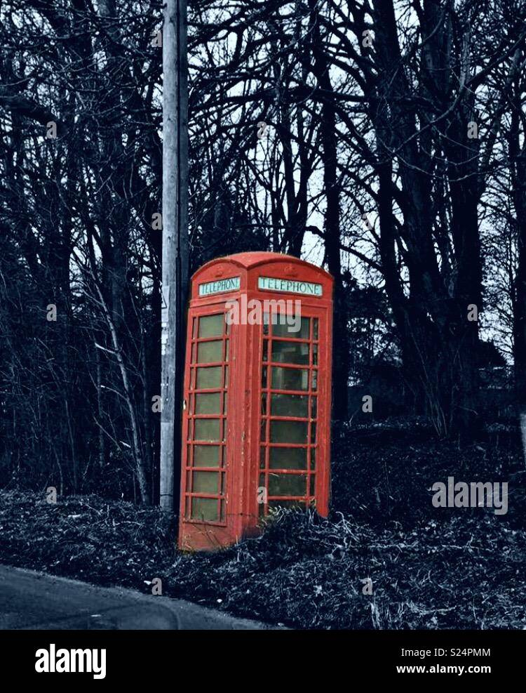 Bright red telephone box - Stock Image
