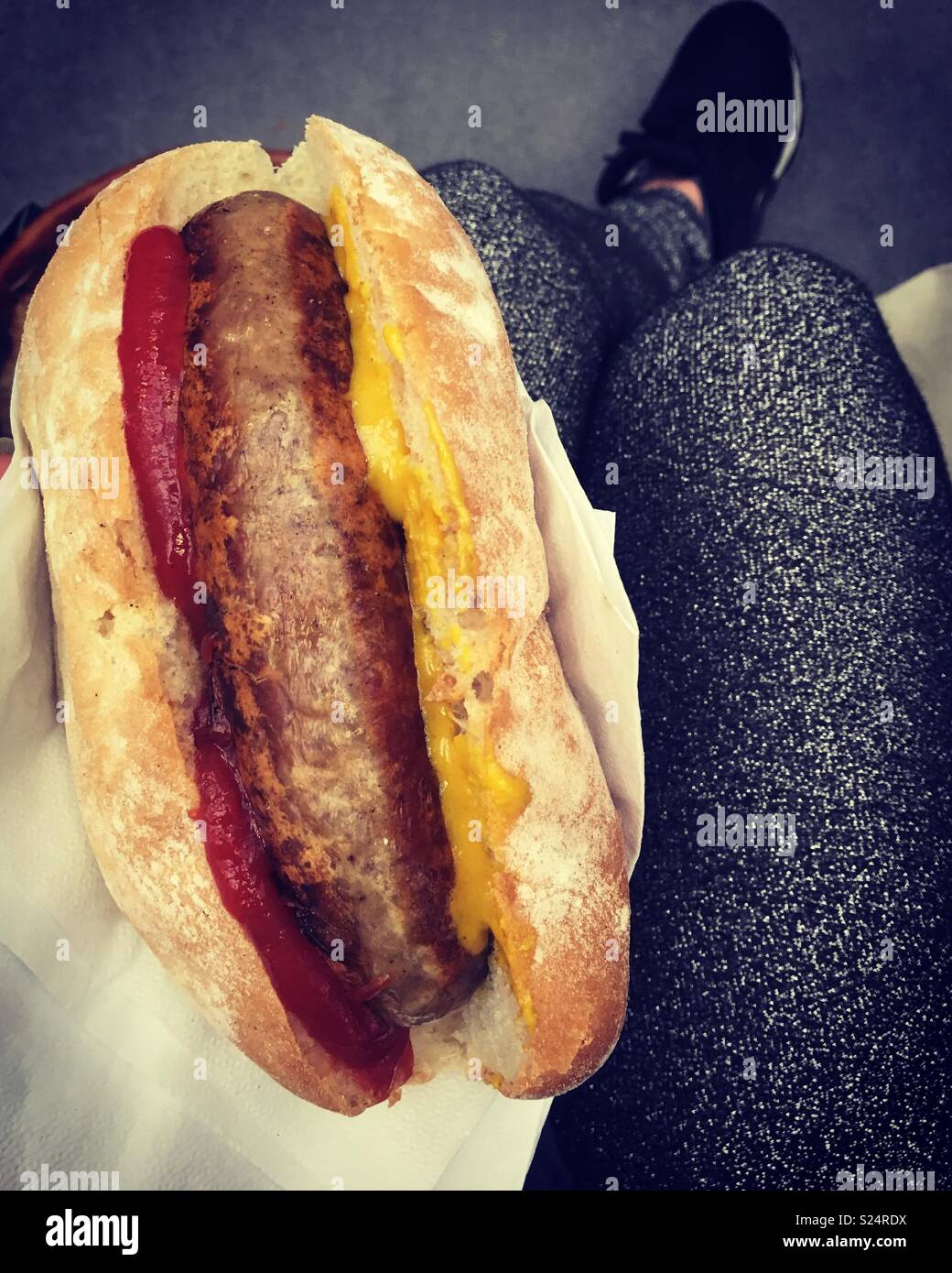 Hot dog, all the condiments and sparkly leggings - Stock Image