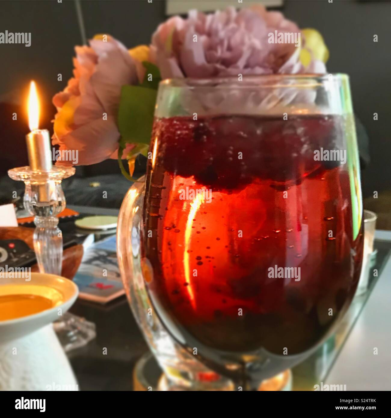 Gin and candles - Stock Image