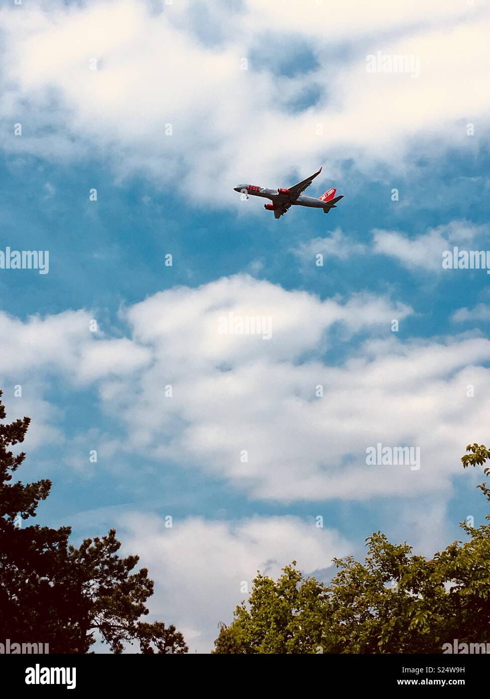 Jet 2 plane flying over Bruntwood Park in Cheadle, UK - Stock Image