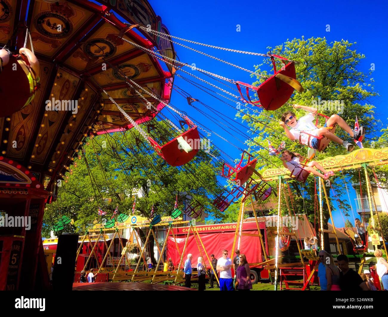Swinging chairs merry go round - Stock Image