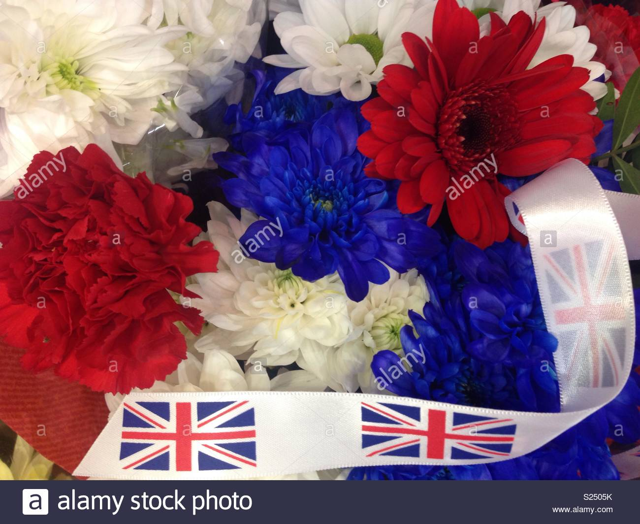 Red white blue flowers flag stock photos red white blue flowers red white and blue flowers with the united kingdom national flag union jack izmirmasajfo