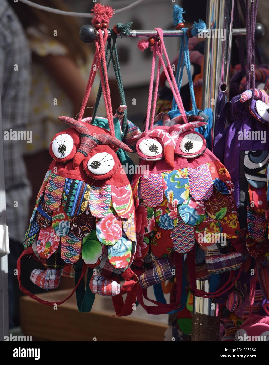 Purses in the shape of owls made from colorful fabric scraps for sale! - Stock Image
