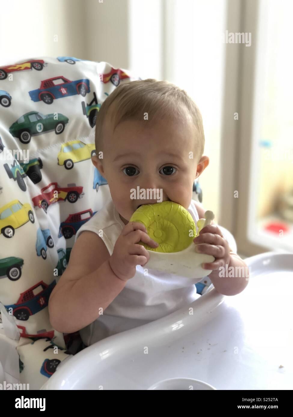Teething baby boy Stock Photo