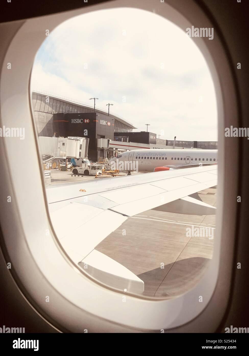 View of Heathrow runway outside of an aeroplane window - Stock Image