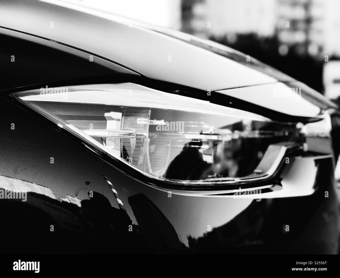 Moscow, Russia - June 24, 2018: BMW 3 Series headlight in monochrome - Stock Image