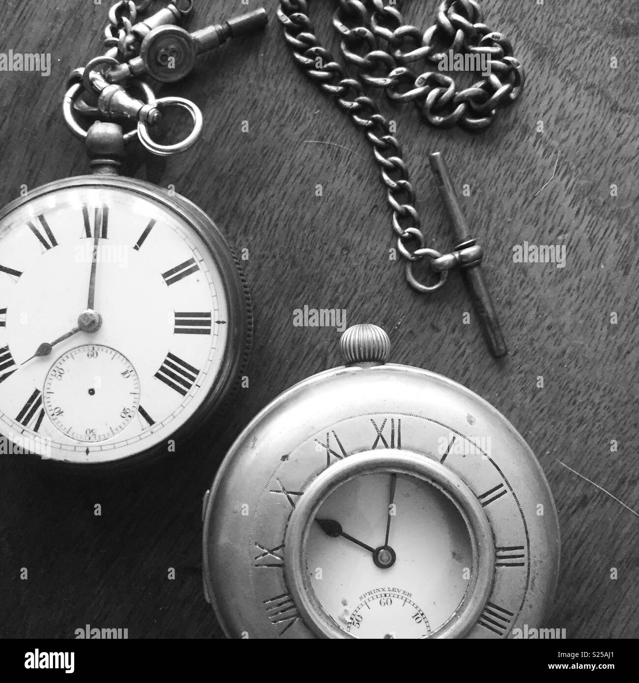 Two old watches on a table - Stock Image