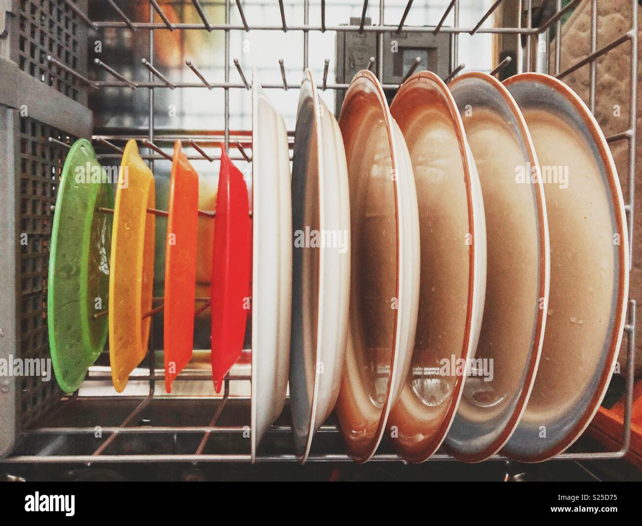 Row of colourful plastic childrenu0027s plates and full size ceramic plates in a dishwasher & Row of colourful plastic childrenu0027s plates and full size ceramic ...