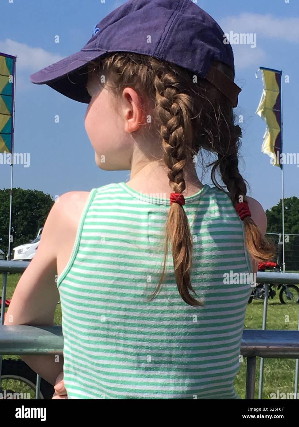 Girl in the festival sun uk - plaits - Stock Image