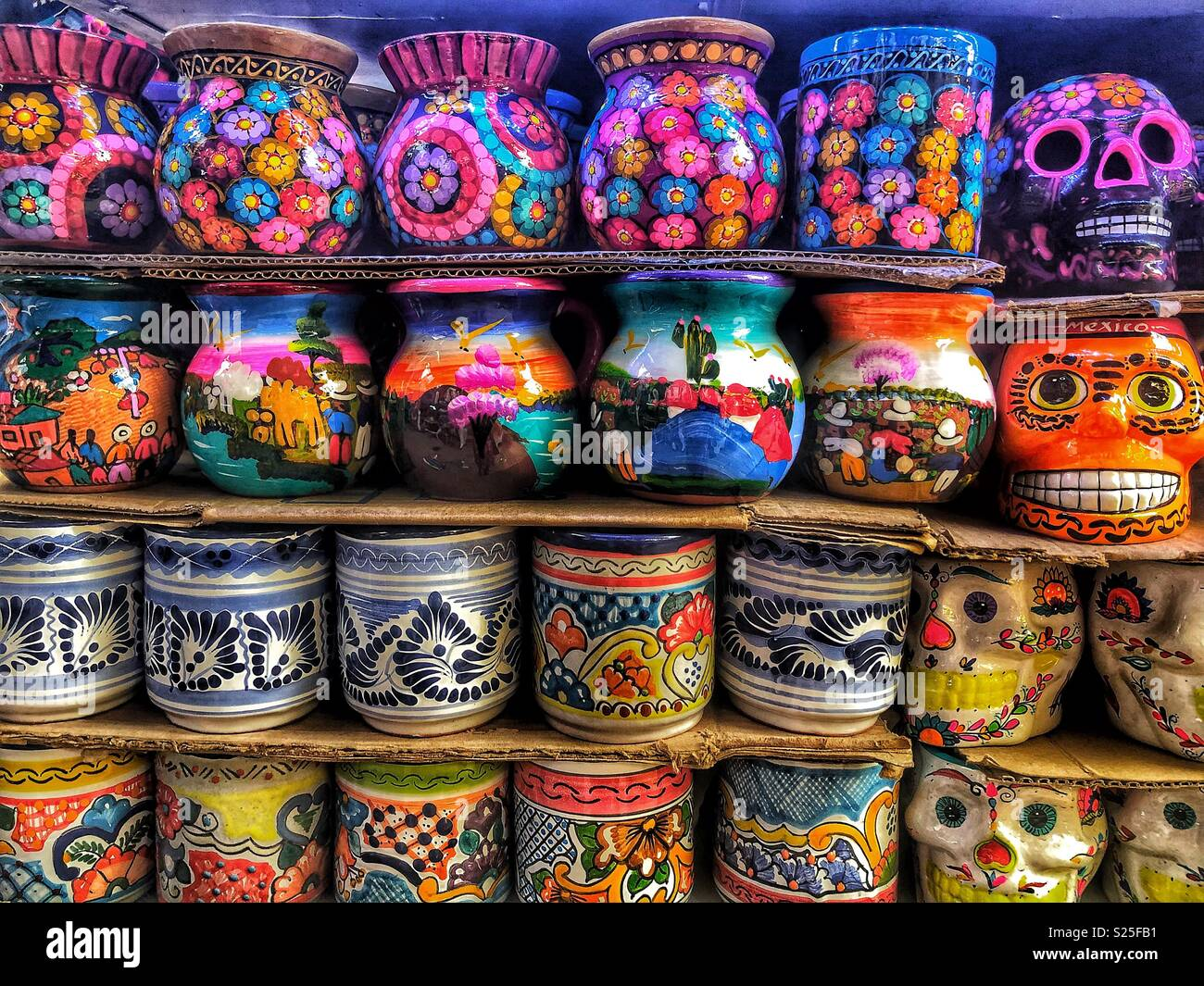 Traditional Mexican Pottery and Skulls In Bright Colors - Stock Image