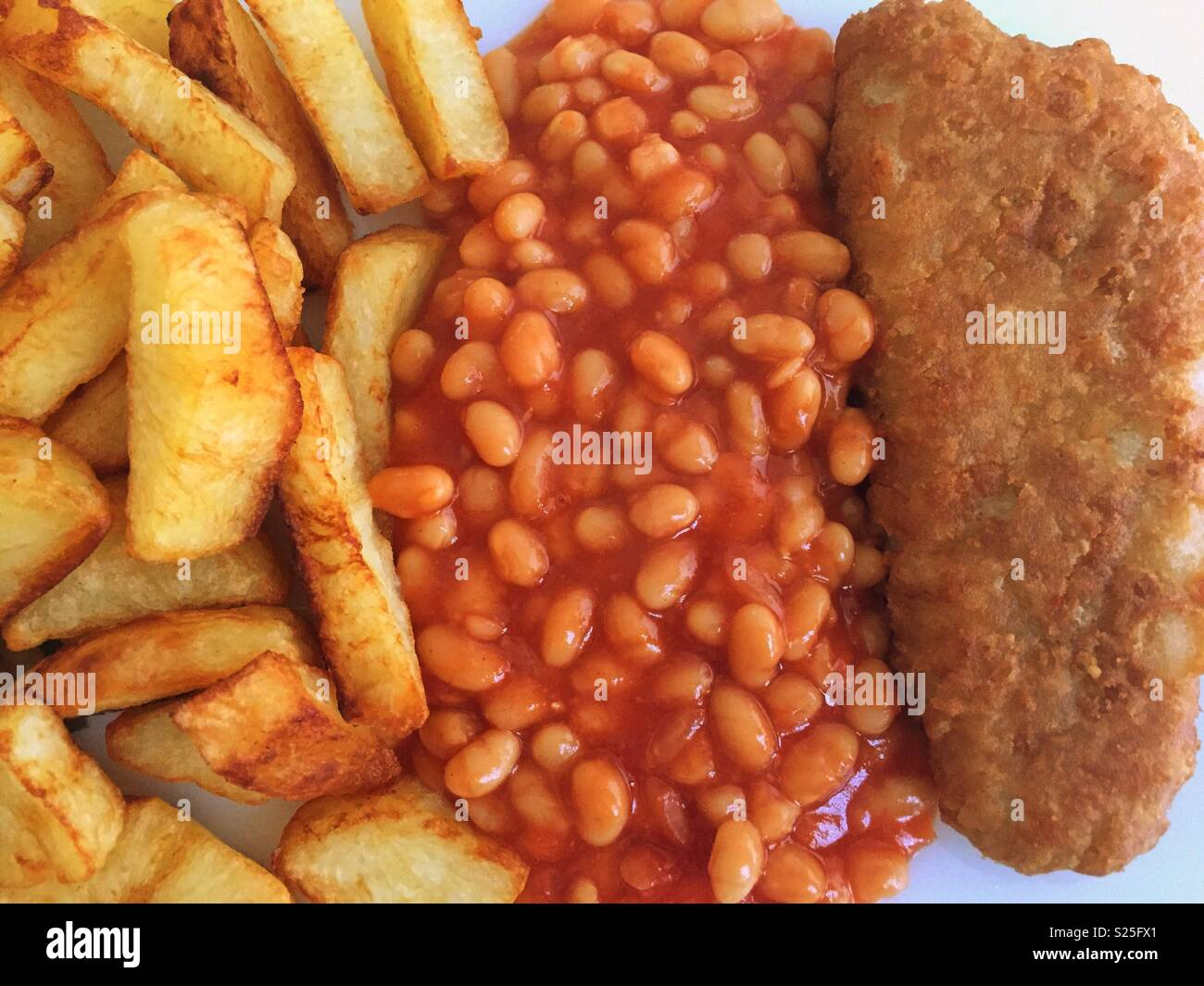 Chips, beans and fish. - Stock Image