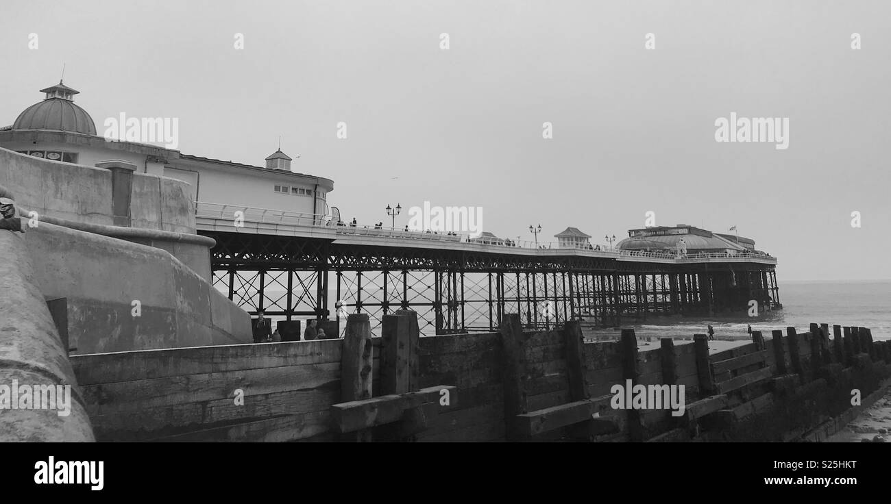 Dull day on Cromer Pier - Stock Image