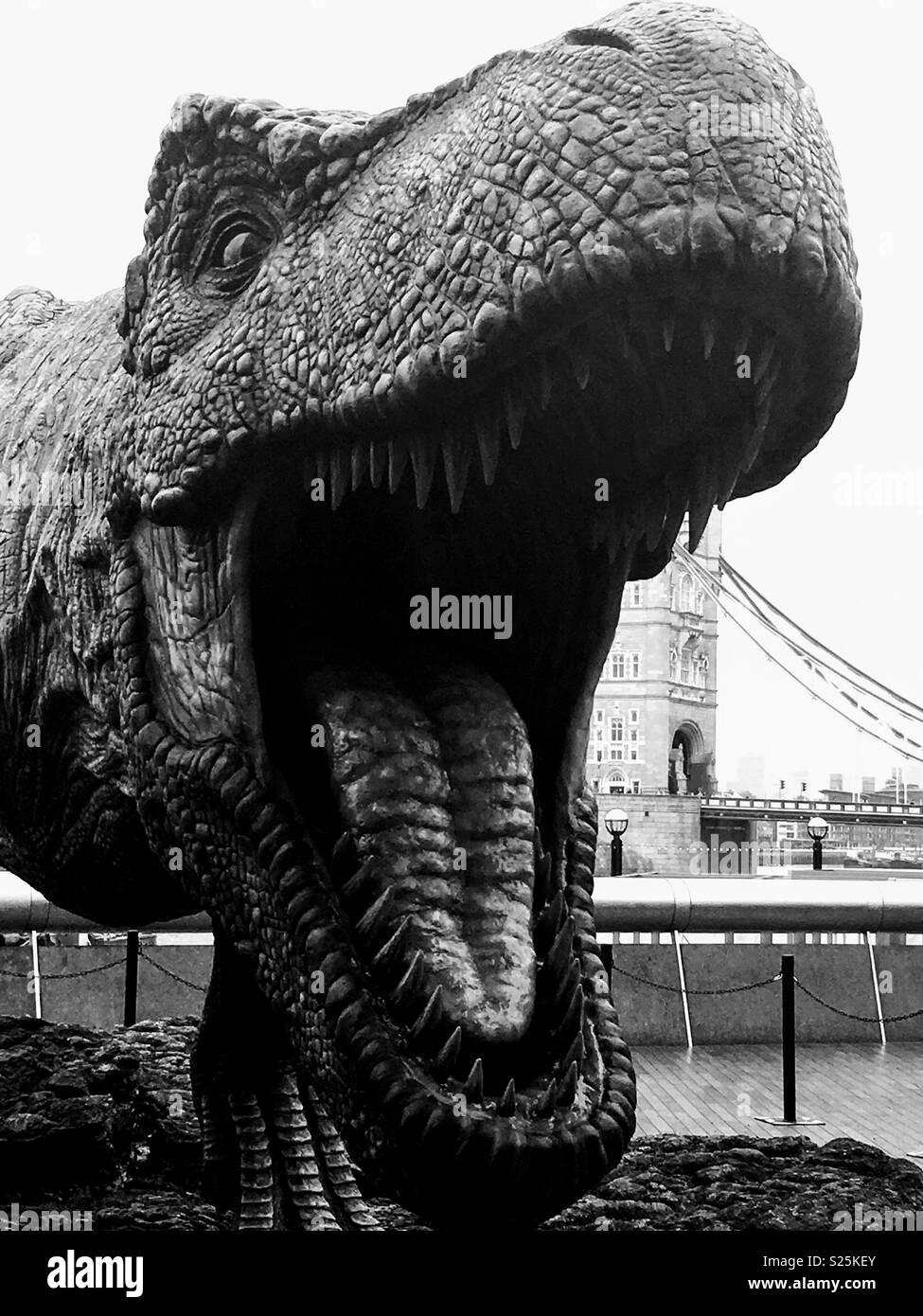 Dinosaur near City Hall and Tower Bridge in London - Stock Image