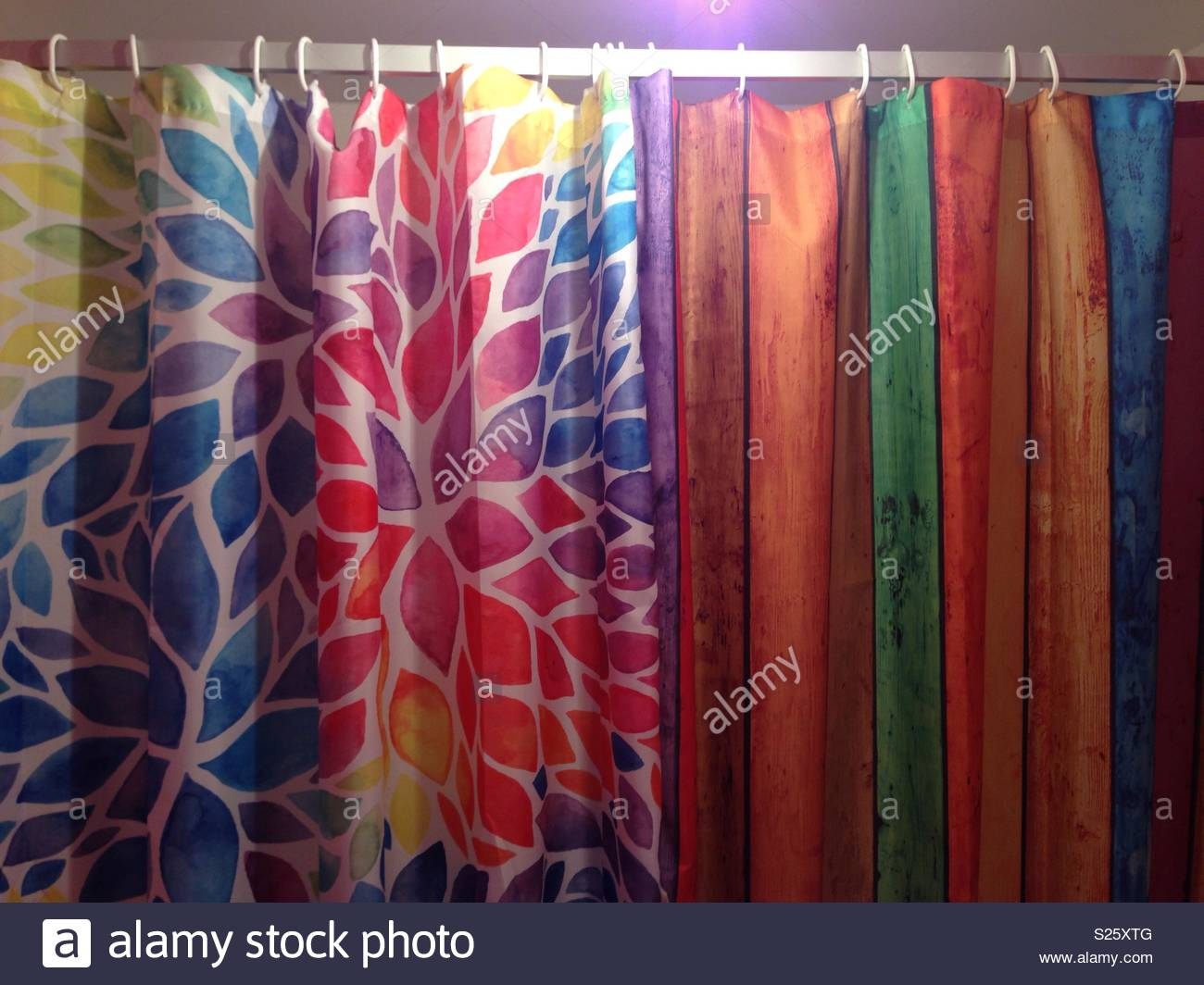 Two Different Bright Vibrant And Colourful Shower Curtains Hanging Together