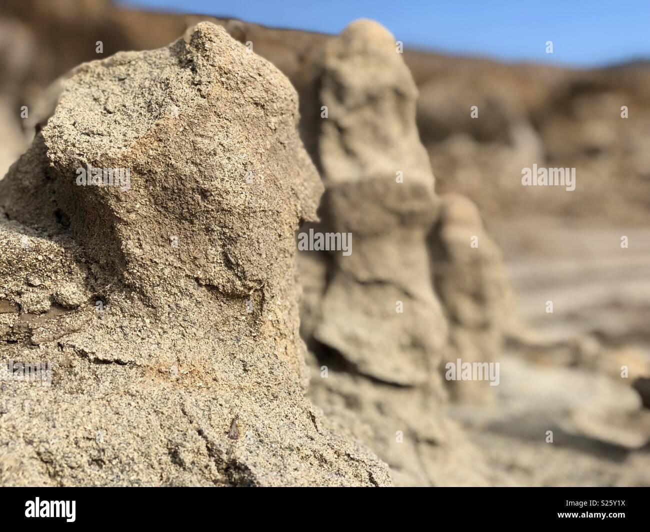 Monumentos naturales de arena que se formaron al bajar el nivel del lago. Colbun, Chile. Stock Photo