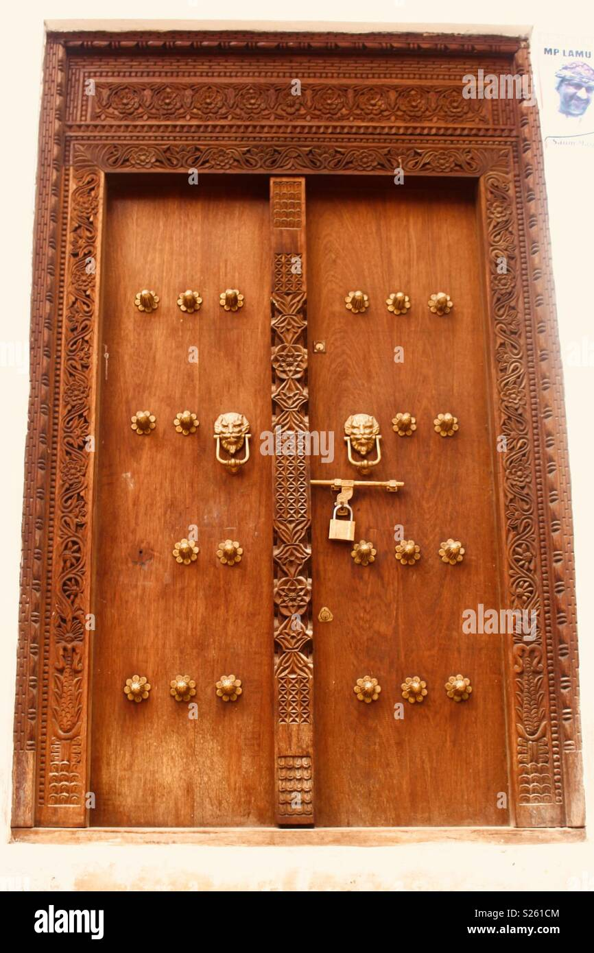 Ornate carved wooden Swahili door in Lamu, Kenya Stock Photo