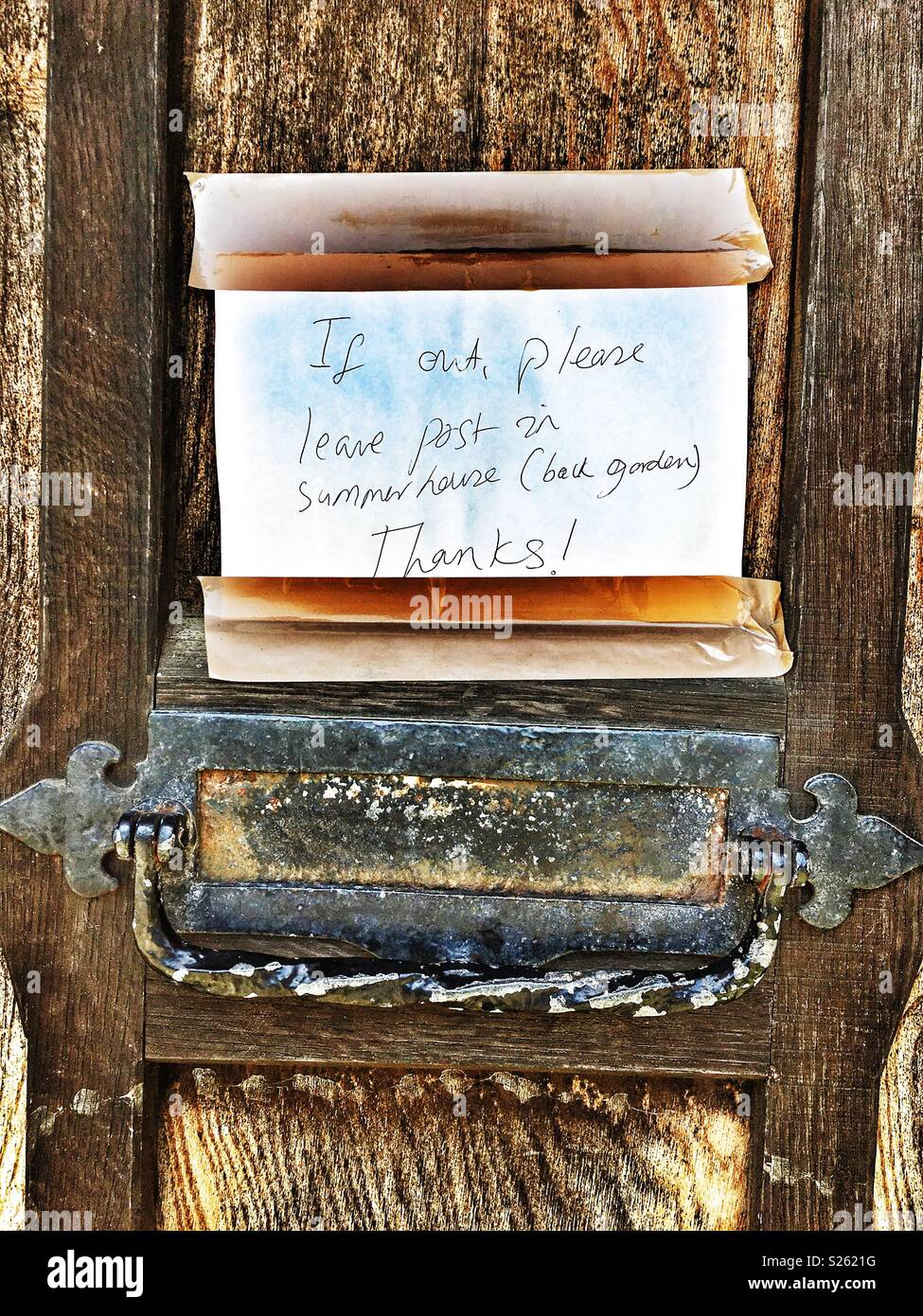 Message on front door for delivery driver. - Stock Image