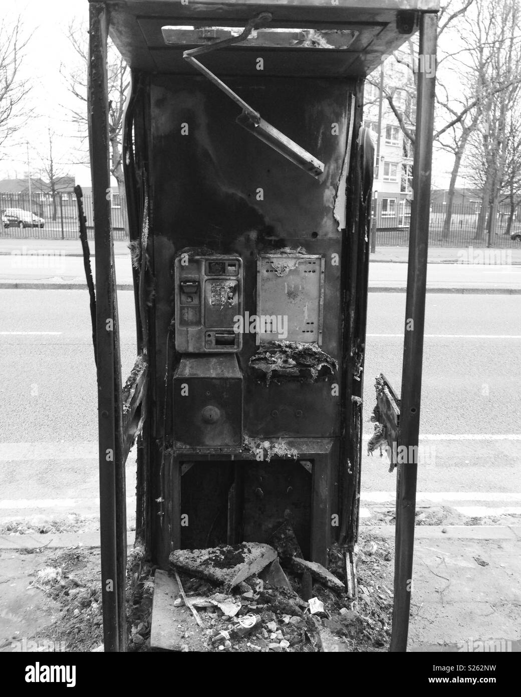 Burned down telephone box - Stock Image
