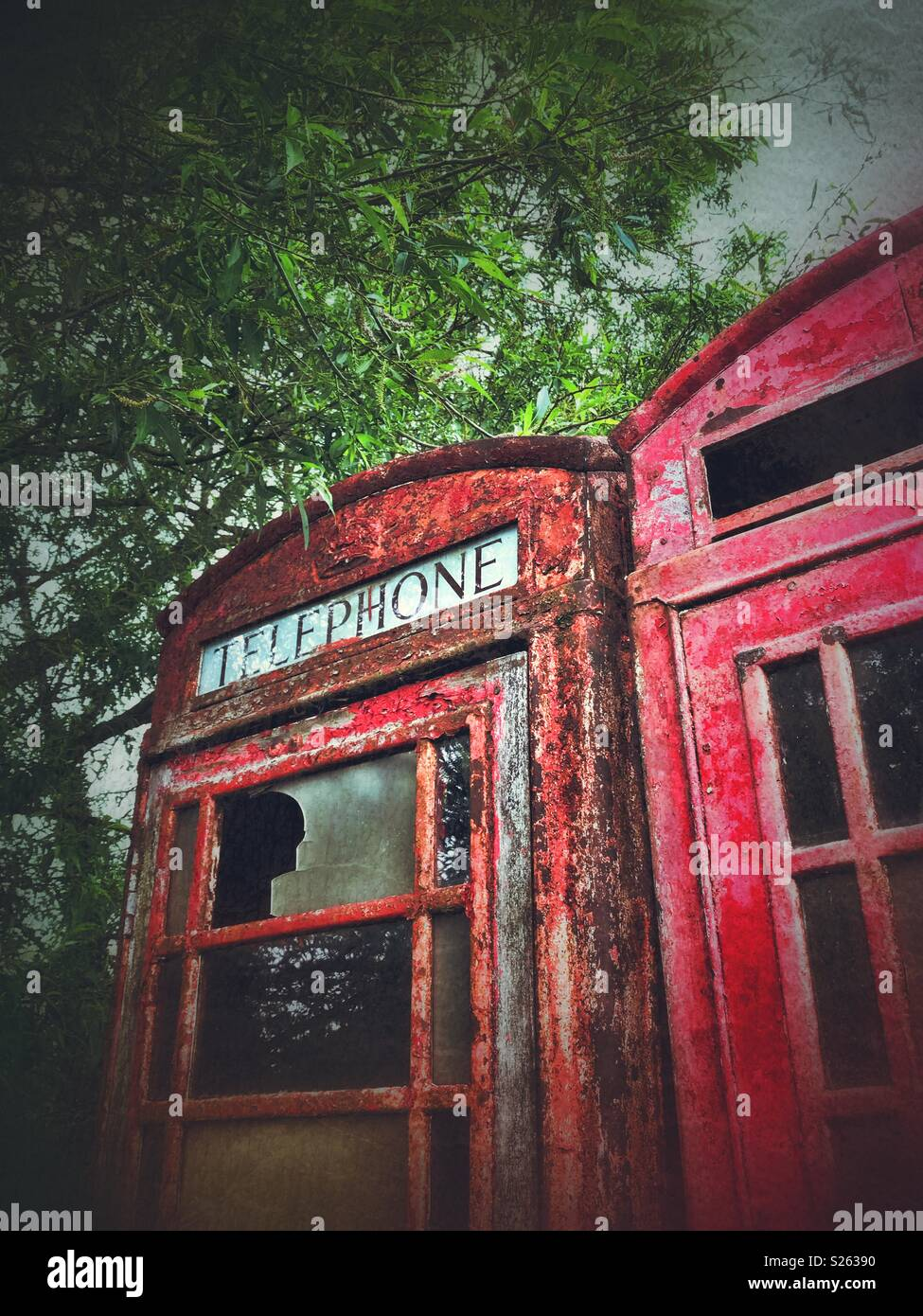 A pair of old telephone boxes - Stock Image