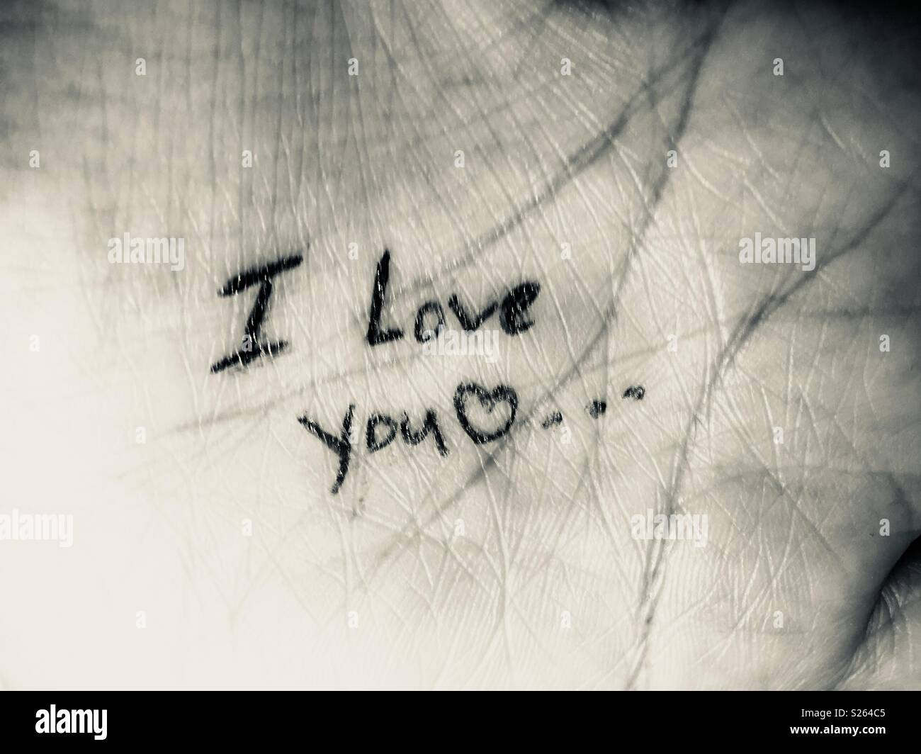 Love note written on a hand. - Stock Image