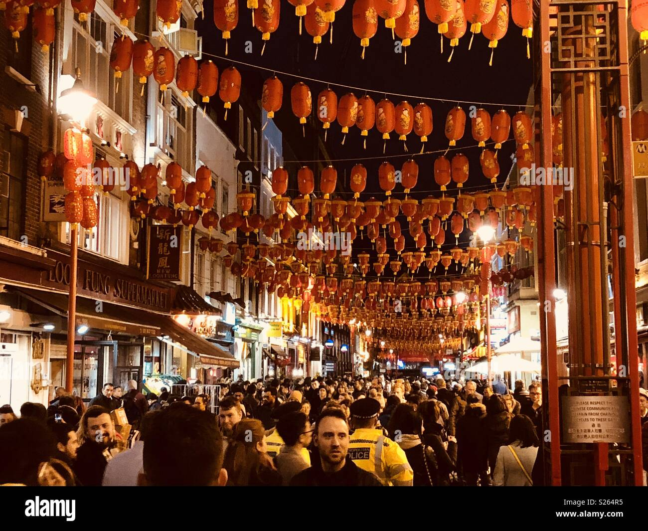 Chinese New year in China town London with hanging lanterns - Stock Image