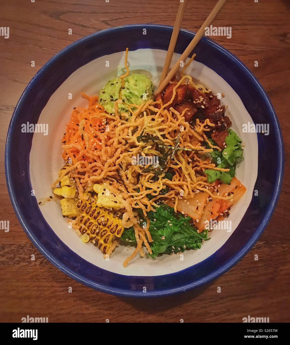 Crispy noodles and pork poke bowl - Stock Image