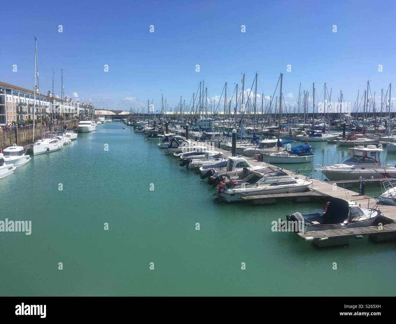 A view of the boats moored at Brighton Marina Village, East Sussex, England. Visited on a sunny Sunday in Summer. - Stock Image