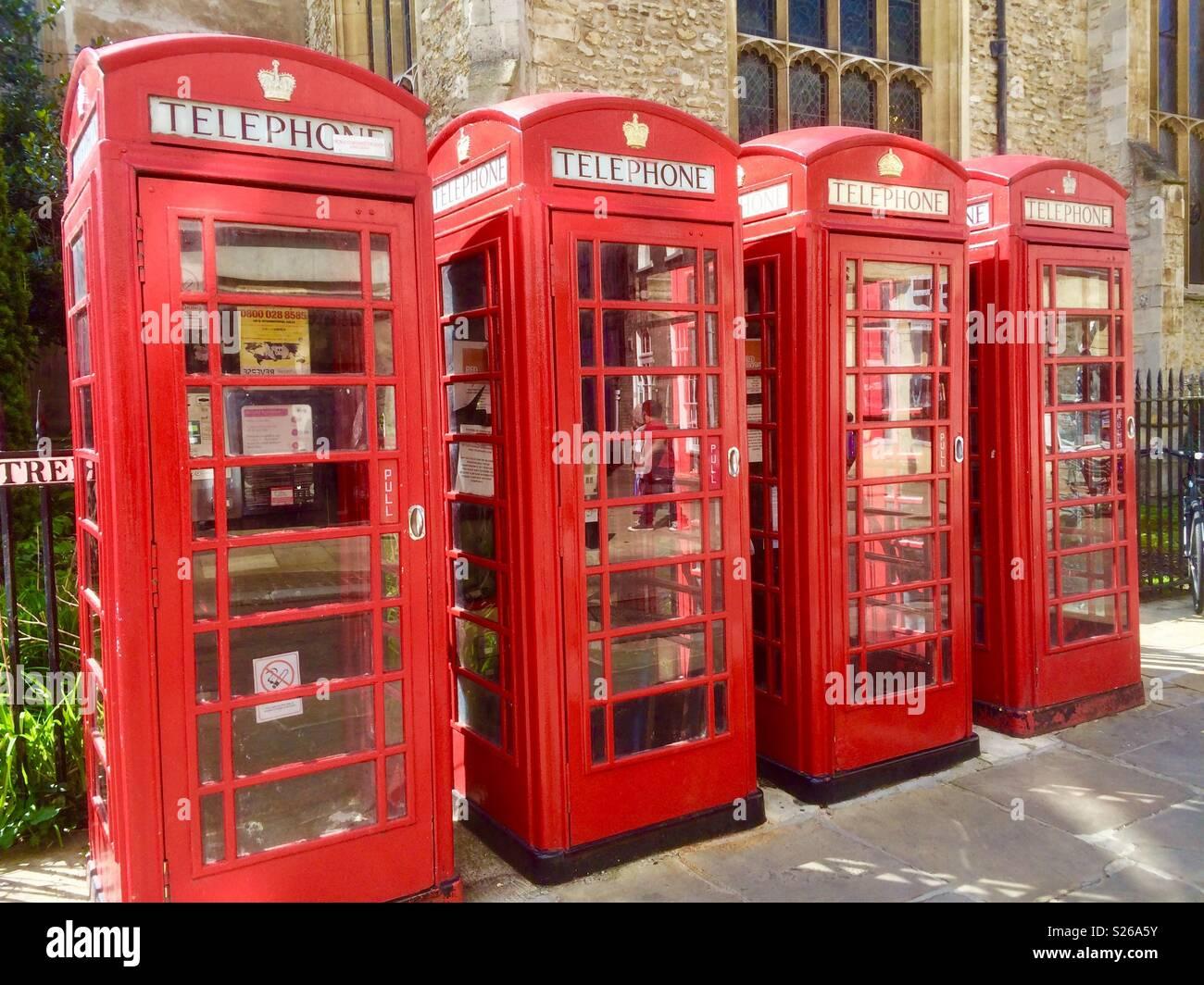 4 Telephone boxes - Stock Image