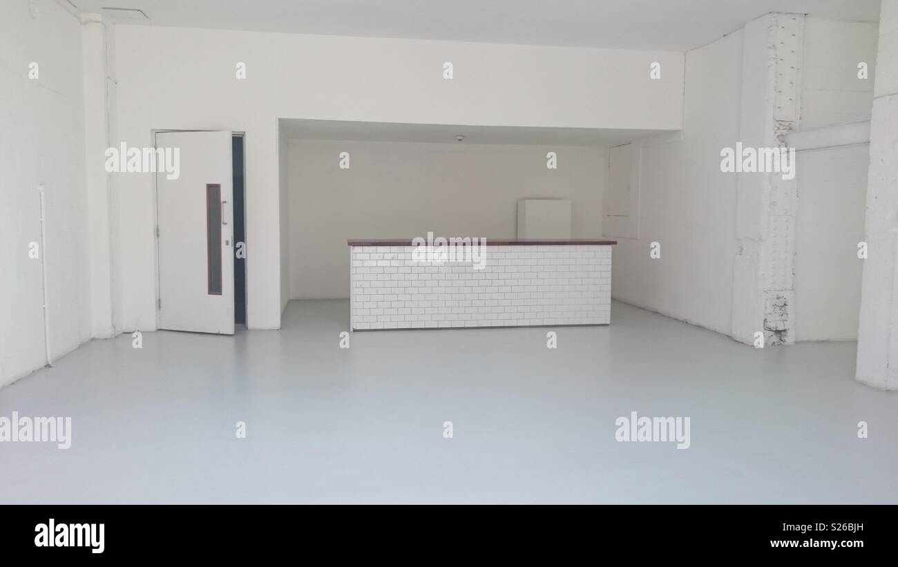 Commercial unit under refurbishment on Southampton Row, Bloomsbury, London. Light coloured decor. Observed midweek in Spring. - Stock Image