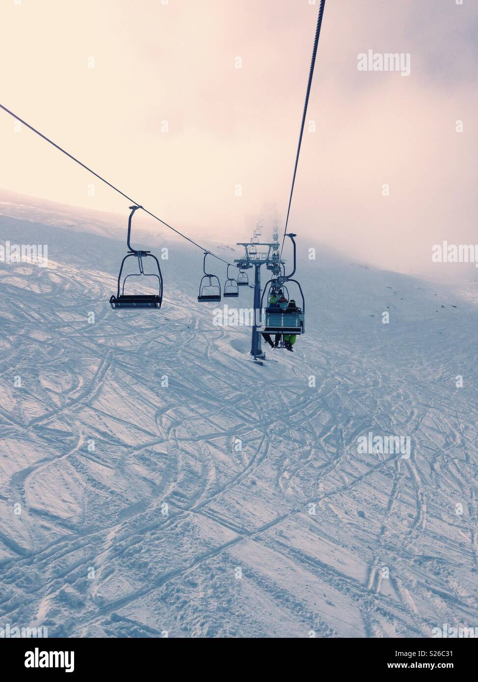 A ski-lift into the clouds - Stock Image