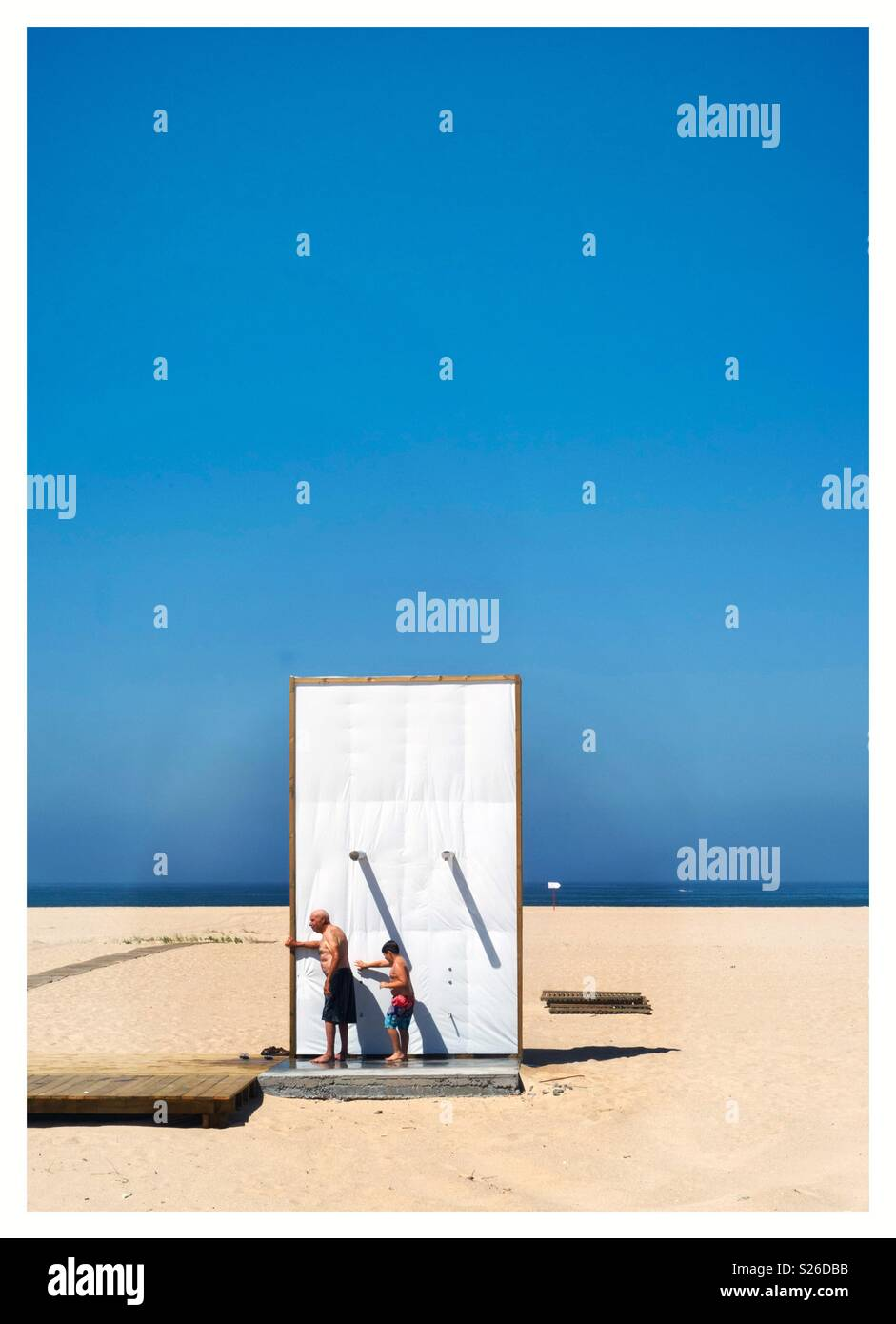 #Portugal#FigueiradaFoz#coast#love#beach#summer#fun#Oldman#Child#Boy#Contrast#light#shadow - Stock Image
