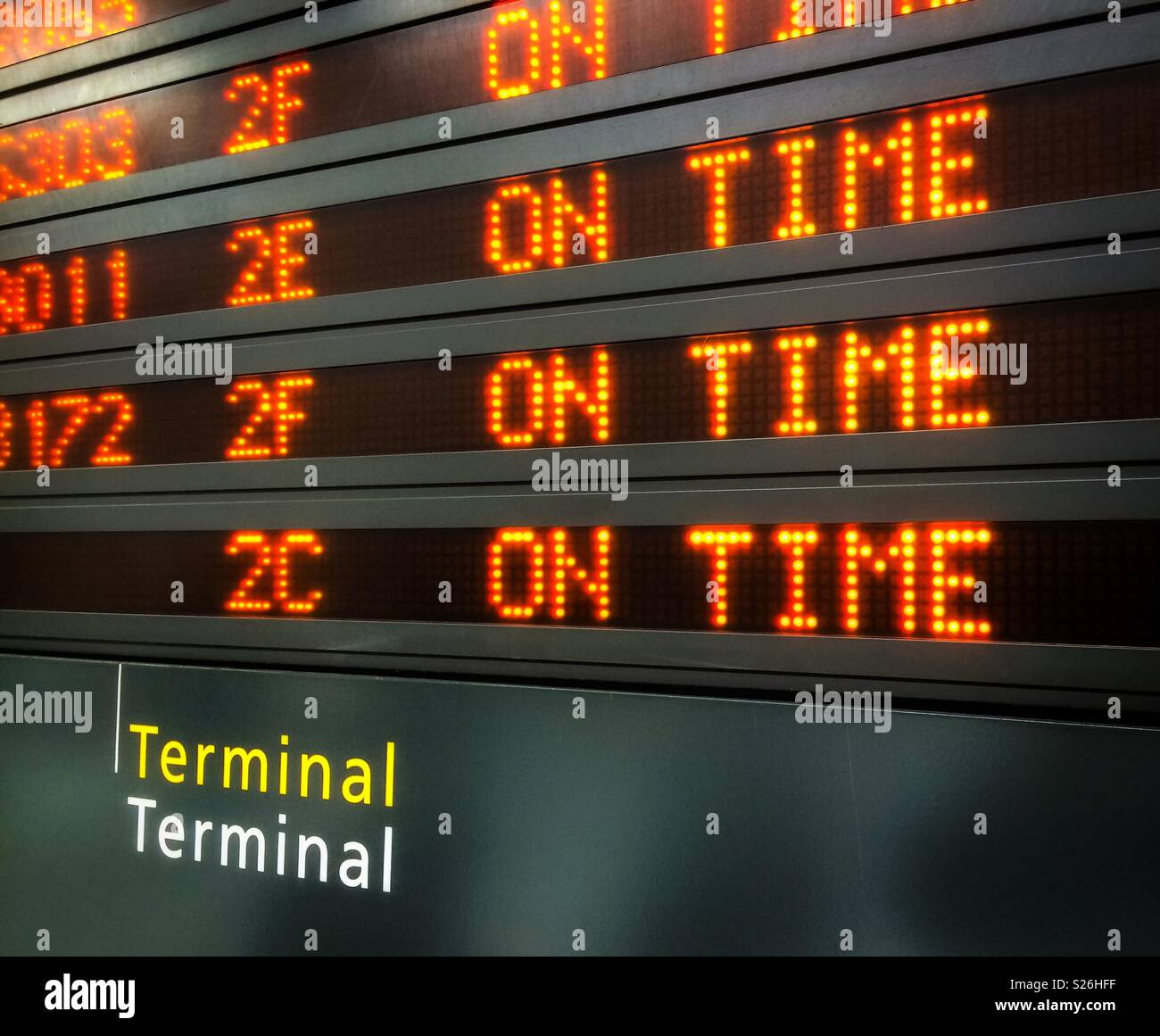 On time. Airport flight information display system showing the schedule of the flights. - Stock Image