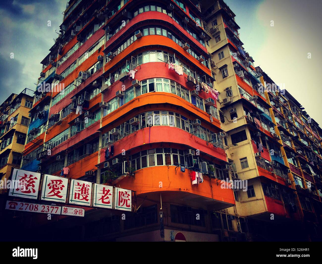 Hong kong. Kowloon side. Mongkok area with its typical old building tower - Stock Image