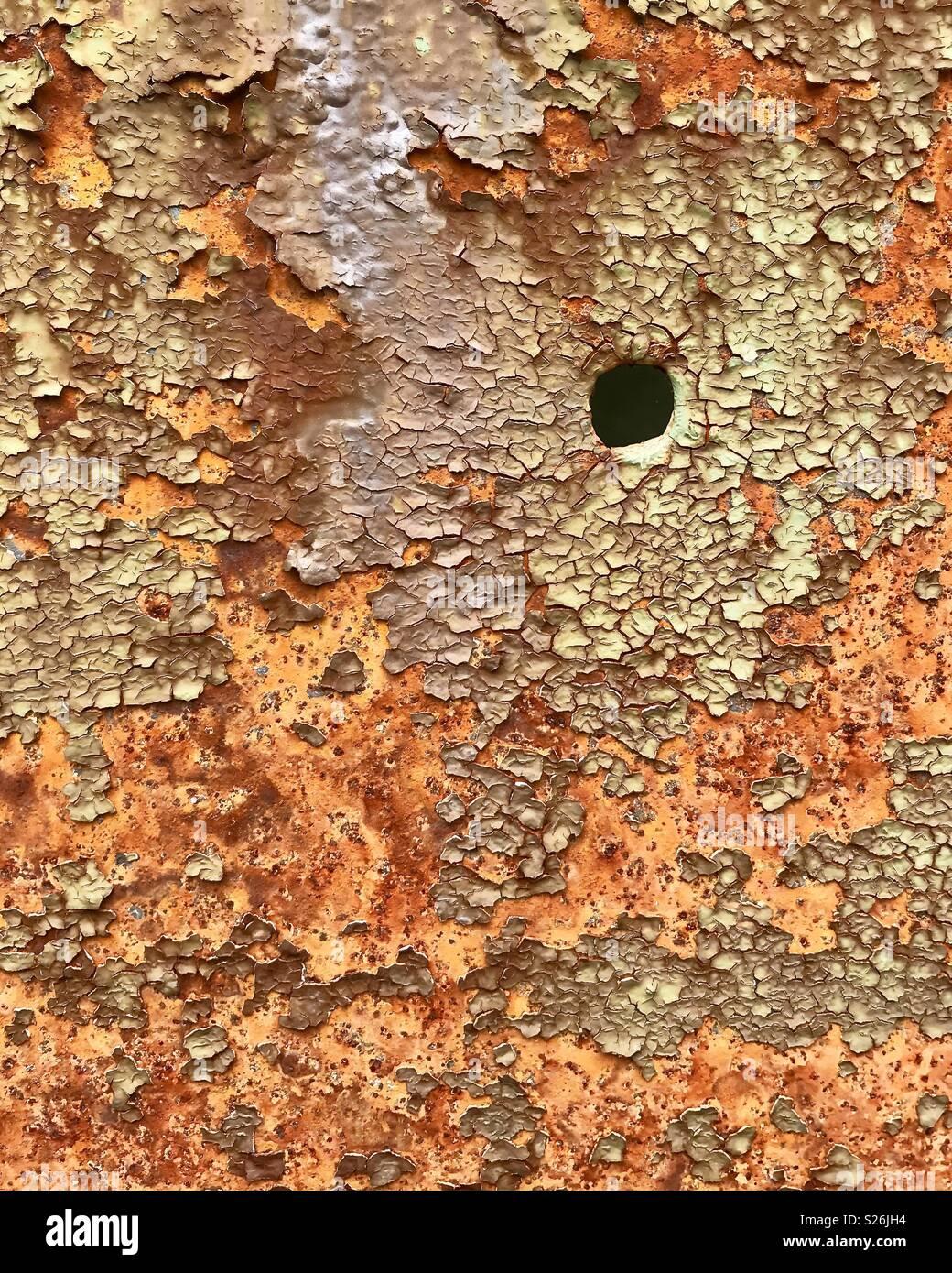 Bullet hole in steel beam - Stock Image