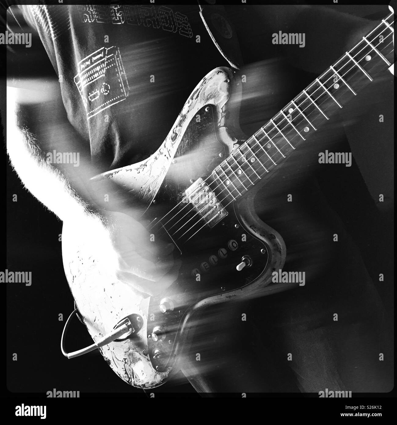 Close view of a rocking guitarist in action. - Stock Image