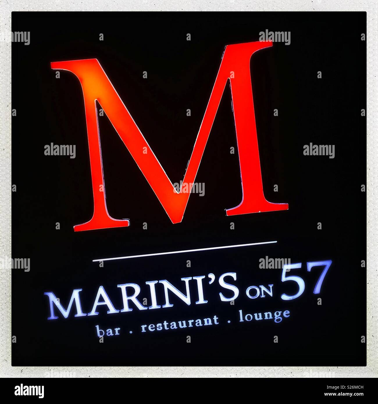 Illuminated sign for Marini's on 57, Malaysia's highest restaurant and bar, located on the rooftop of Petronas Tower 3, Kuala Lumpur, Malaysia - Stock Image