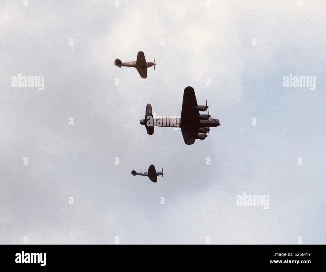 RAF Lancaster Bomber, Hurricane and Spitfire flying in formation. - Stock Image