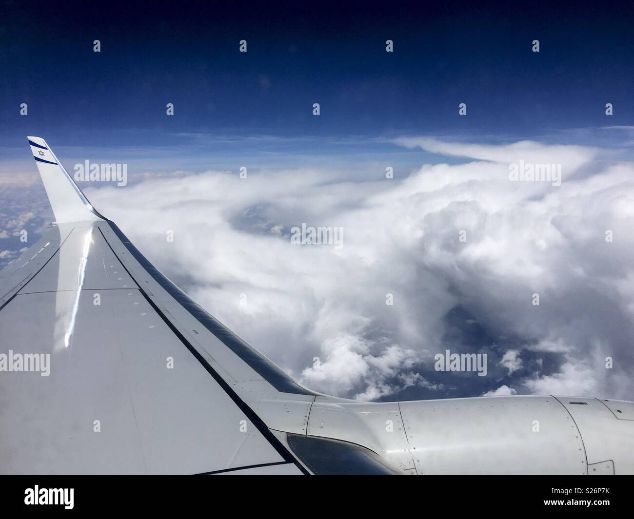 View from El Al aeroplane window of clouds in sky - Stock Image