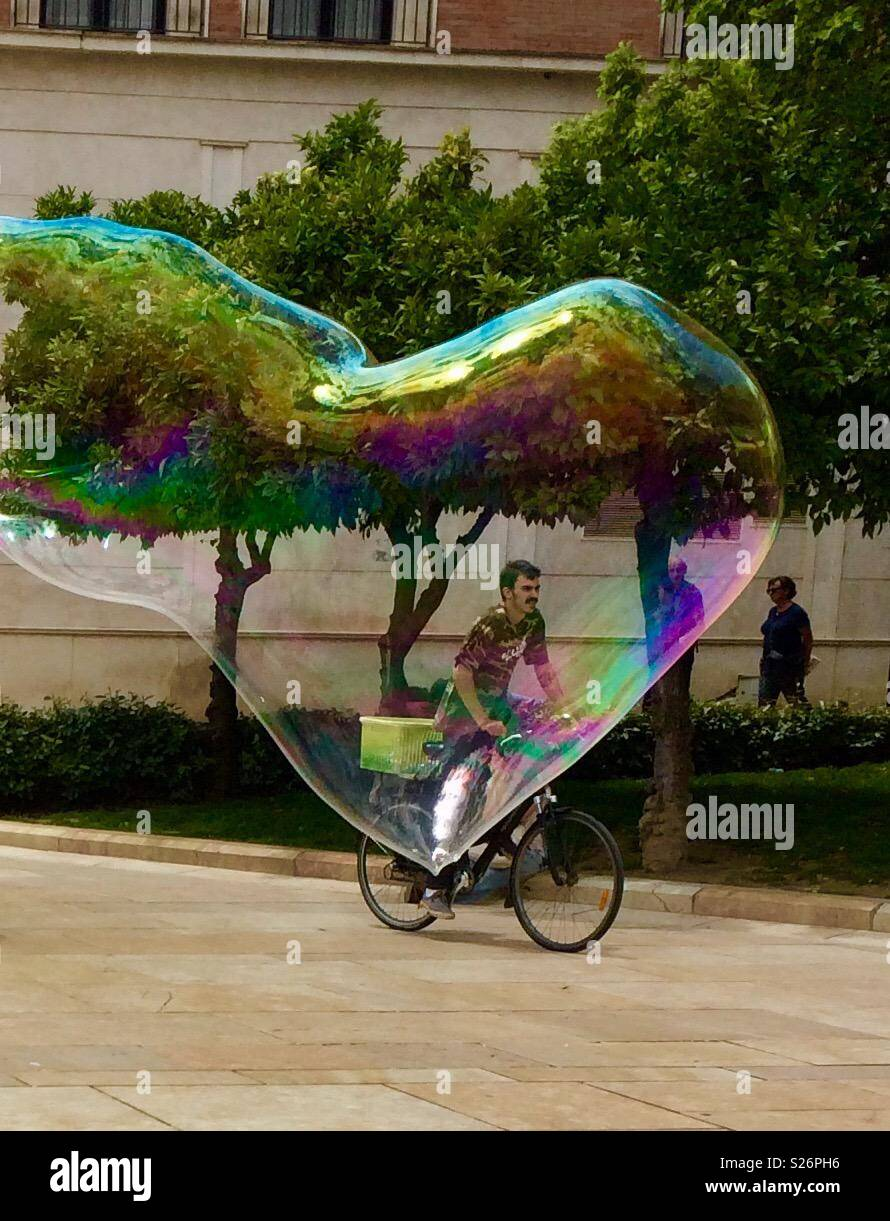 Cyclist caught in a bubble; - Stock Image