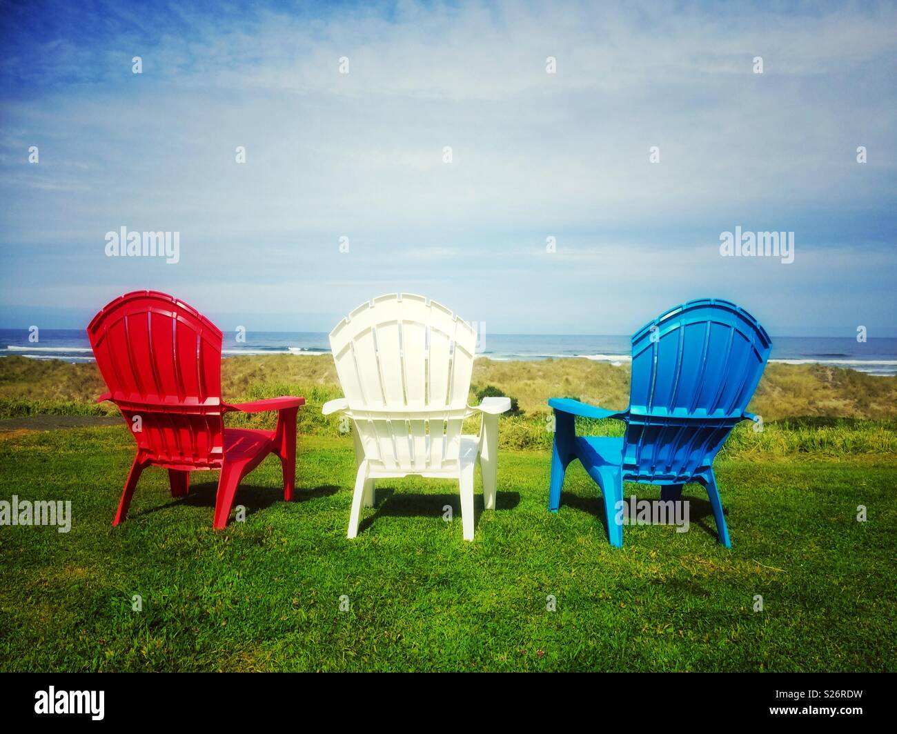 Tremendous Three Red White And Blue Chairs On The Lawn Towards The Short Links Chair Design For Home Short Linksinfo