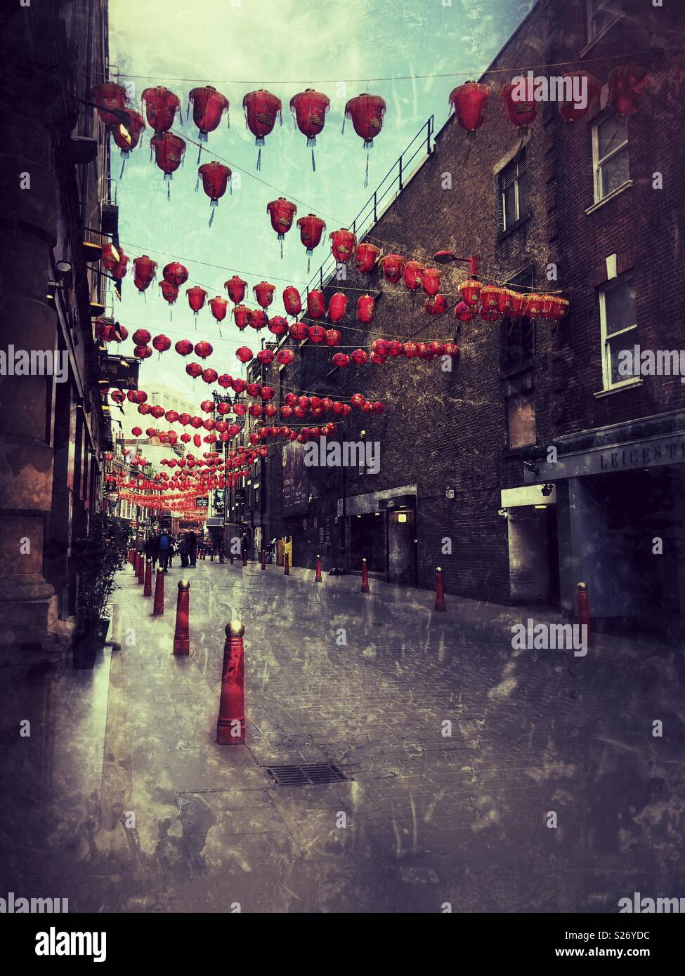 Grainy photo of Chinatown, London with Chinese lanterns bunting - Stock Image